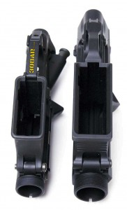A side by side bottom view visual comparison of the MEGA ARMS MA-TEN 308AR Receiver Set for the .308 Winchester Cartridge and a Spikes Tactical AR15 Receiver Set for .223 Remington Cartridge - 308 AR15 , AR15 vs AR-10 308AR AR308