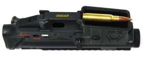 Bottom view of a Spikes Tactical AR15 Lower Receiver with a .308 Winchester Cartridge laying across the Magazine Well - 308 AR15 , AR15 vs AR-10 308AR AR308