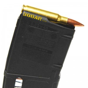 Right Side View of a .308 Winchester cartridge placed on a Magpul PMAG .223 AR15 Magazine - 308 AR15 , AR15 vs AR-10 308AR AR308